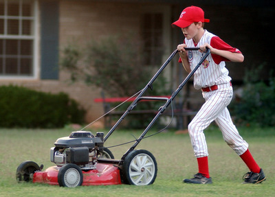 image of a man mowing the lawn